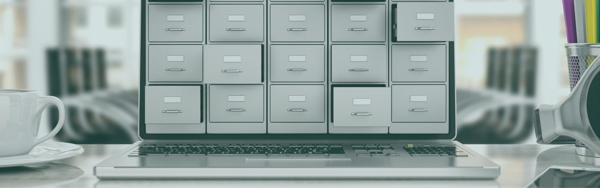 Card catalog cabinet and laptop