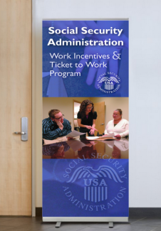 Display banner featuring an employee signing to other employees